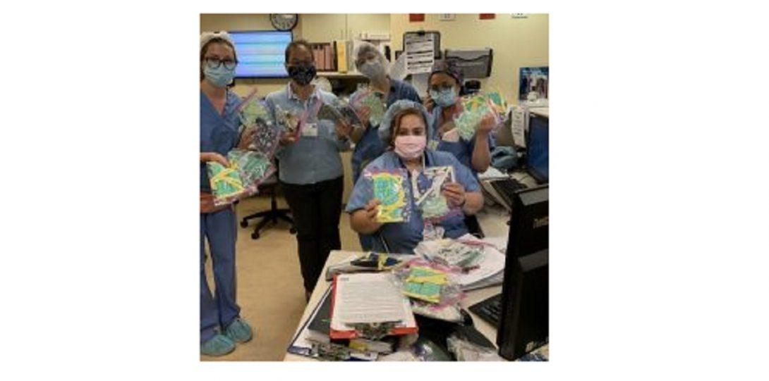 nurses holding masks