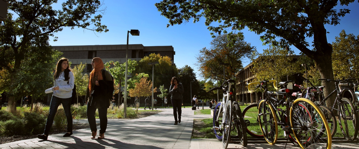 Students walk across UIC's east campus on a fall day.